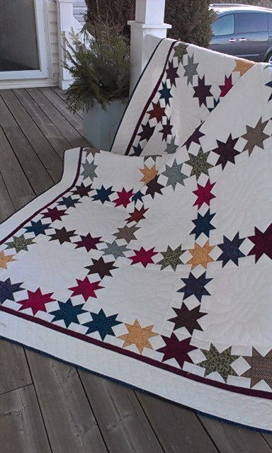 Lots of stars  Just a 9-patch with the star blocks and an alternating white block.  What a stunning quilt.  Love the solid space for lots of beautiful hand quilting!