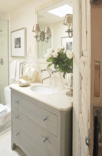 Gray and Off-White Cottage Bathroom | this sort of vanity with an old door or shutter as a divider between toilet