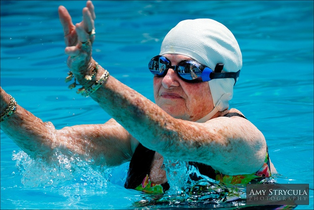 This 95 Year Old Swimming In A Swimming Pool Wearing A