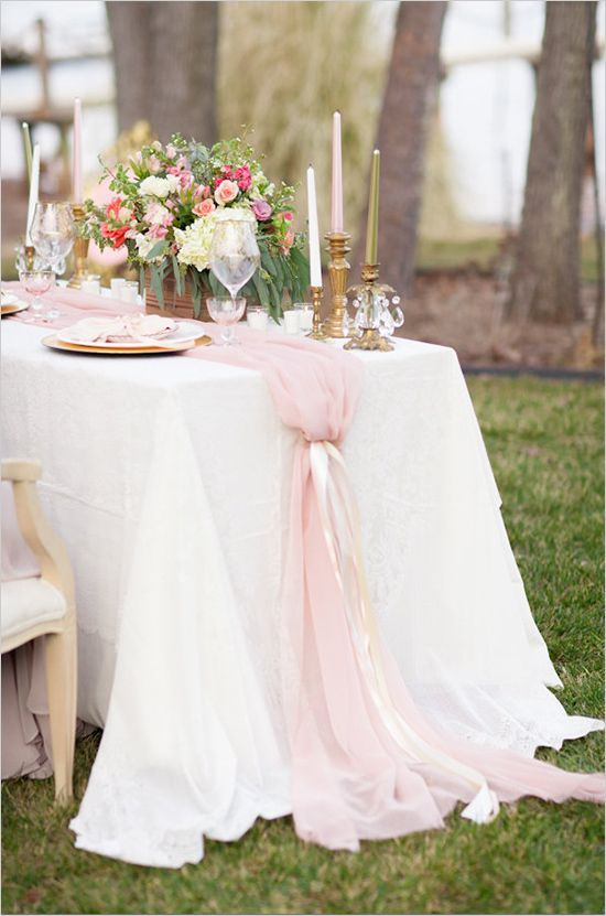 Pink tulle table runner - so romantic. Mirror charger,  centerpiece vase Navy ribbon, lace and and bling overlay.  Baby breath and blush pink roses. Stands of pearls.