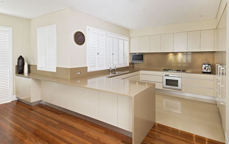 A custom kitchen with extra long breakfast bar to accommodate the family. Sydney, NSW