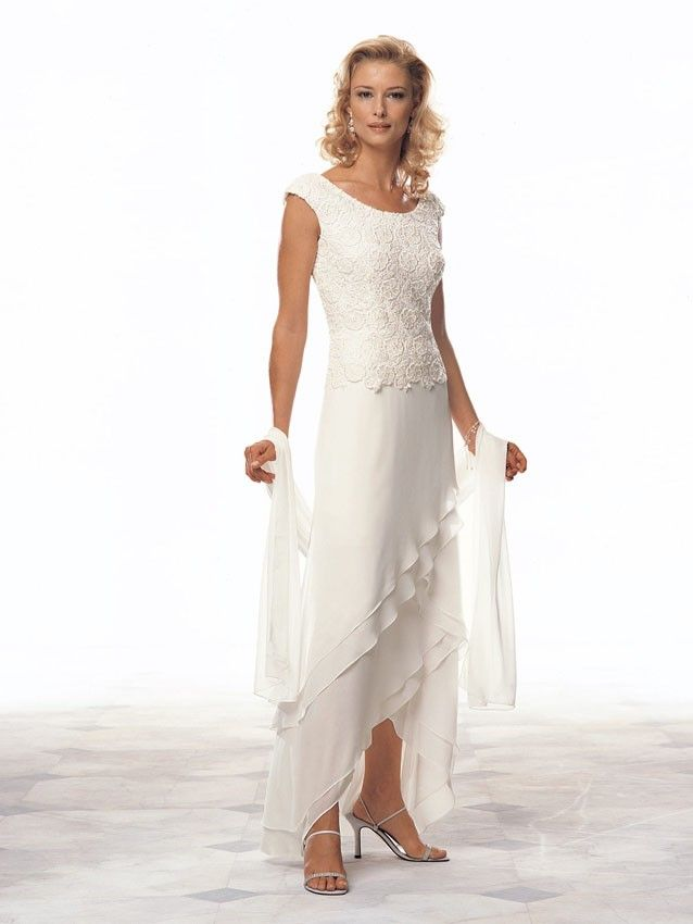 Cameron Blake 13673 Chiffon tip of the shoulder A-line dress with Venise lace bodice and chevron layered skirt with high low hemline. Matching shawl included.