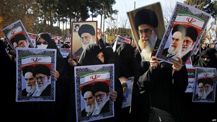 IRAN:  UN to Hold Emergency Meeting on Iran Unrest - January 4, 2018.   Pro-government demonstrators hold posters of Iran's supreme leader, Ayatollah Ali Khamenei (L) and Iran's founder of Islamic Republic, Ayatollah Ruhollah Khomeini during a march in Iran's holy city of Qom.
