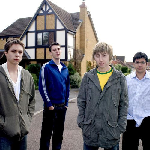 The Inbetweeners - Simon Cooper (Jo Thomas), Neil Sutherland (Blake Harrison), Jay Cartwright (James Buckley), Will McKenzie (Simon Bird)