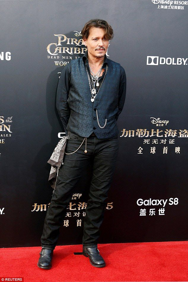 Leading man:Johnny, who plays Jack Sparrow, stuck to his signature quirky style layering a waistcoat over a black shirt accessorised with pendants