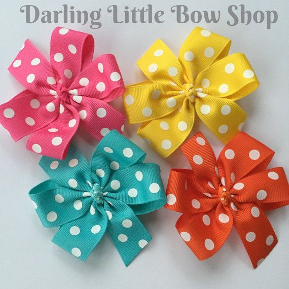 Set of four pinwheel bows in fun, bright colors Yellow, Turquoise, orange and Hot Pink with white polka dots. Great set for back to school! Each bow is approx. 3 across and attached to an alligator clip, lined with non slip grip so bows stay in Customization welcome! Want two pinks? Red instead of orange? Mention at checkout! When will this ship? Check the FAQs - http://etsy.me/1l2hCJa Why will you LOVE Darling Little Bow Shop bows?? *high quality ribbon *hand sewn bows *bea...