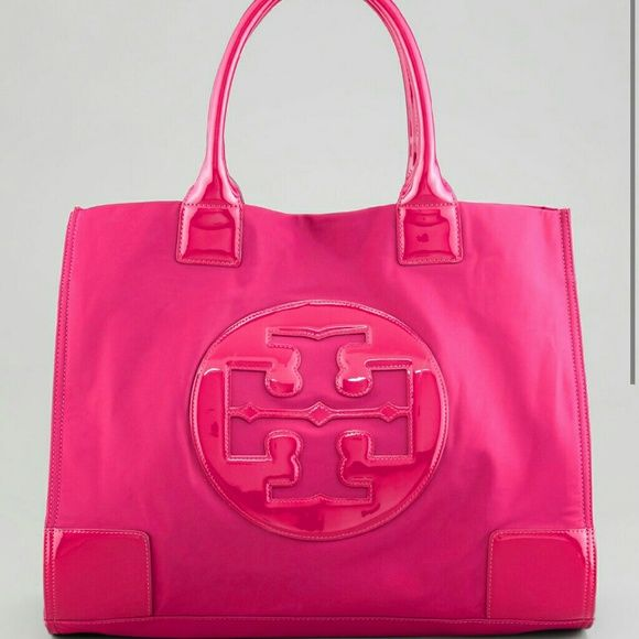 Tory burch Nylon tote bag in Pink A cute hot pink nylon tory burch bag I had for years and worn the bag shows signs of wear but is it great condition minor scuff on bottom of bag but again in great condition the handles have sign of wear *NO TRADES* Tory Burch Bags Totes