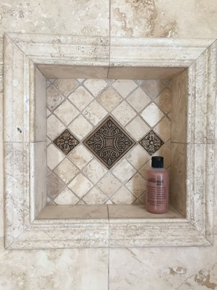 Niche to hold shampoo outlined in travertine pencil and