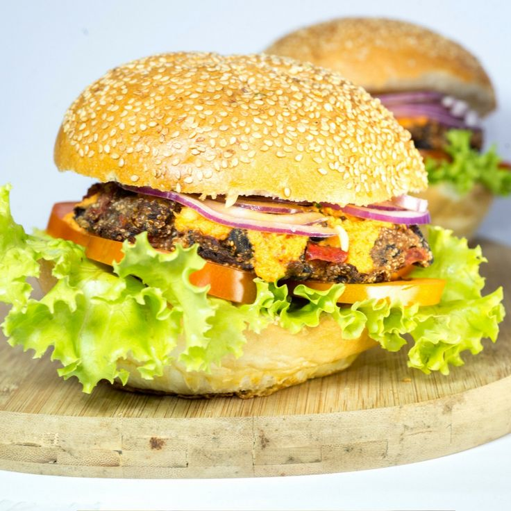 Smoky Amaranth & Black Bean Burger with Red Bell Pepper Sauce. Click Visit for the recipe on our blog.