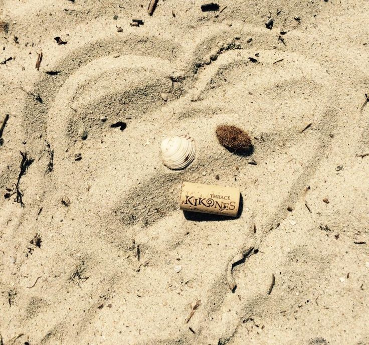 Toes in the sand and wine in my hand. #corks #summerwine #kikones #Thrace #winelovers