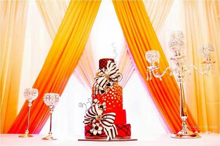 Red black and white wedding cake. Colourful wedding cake