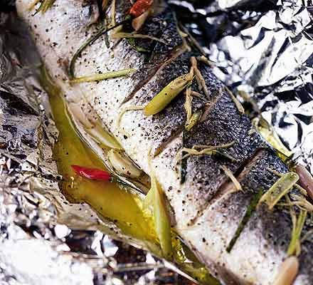 Baked sea bass with lemongrass & ginger    35 mins Super healthy   1 whole sea bass (about 1.4kg/3lb), gutted and cleaned  3 lemongrass stalks, cut diagonally into 2.5cm pieces  2 small chillies , halved  2 garlic cloves , halved  3cm piece fresh ginger , peeled and cut into thin strips  1 tsp runny honey  2 tbsp olive oil  2 limes  2 kaffir lime leaves (use a few strips of lime peel if you can't get these)