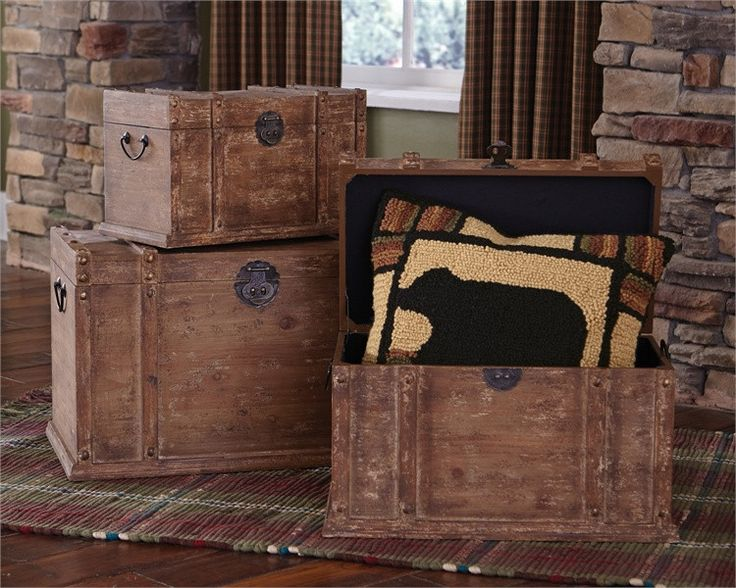 These trunks nest inside of each other and are perfect pieces for when you need additional storage. Features a distressed time worn look for a vintage feel. Accessories not included. Dimensions: Large