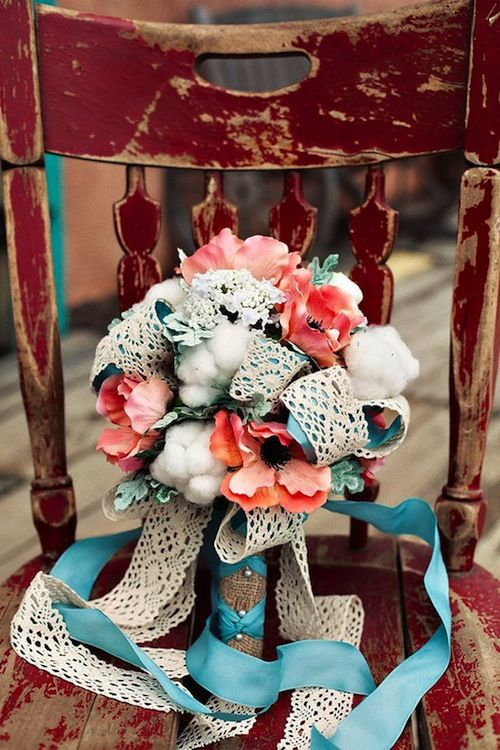 Loops of lace and ribbon in a bouquet! It's even a turquoise ribbon.