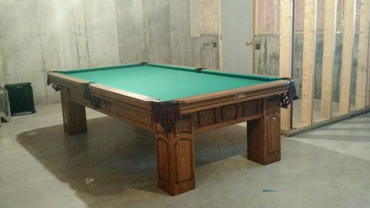 Connelly Chirachaua pool table shown in Medium on oak. The Chirachaua and all other Connelly pool tables are available at Maine Home Recreation.