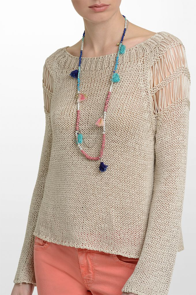 Sarah Lawrence - long sleeve sweater, skinny denim pant, beaded necklace with tassels.
