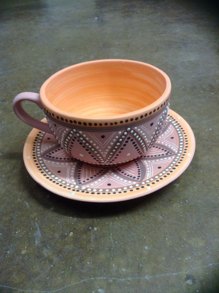 Ceramic painted t-cup and saucer by Lisa B's Art studio.