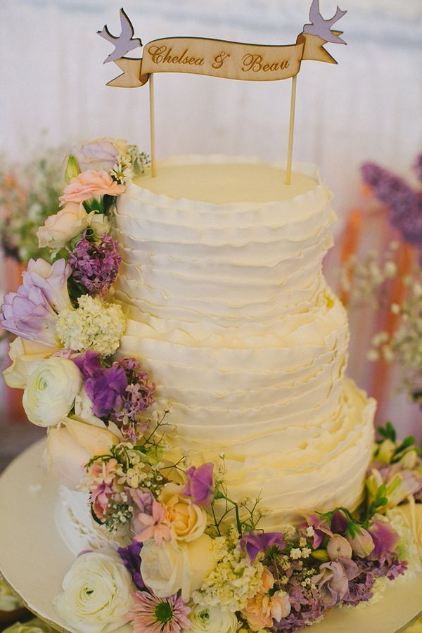 flowing flowers cake, photo by Bek Grace http://ruffledblog.com/garden-queensland-wedding #flowers #cakes #weddingcake