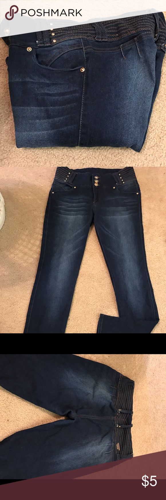 Dark denim jeans with gold buttons Barely worn dark denims. Gold buttons to accent. No zippers and no pockets in the back. Jeans Skinny