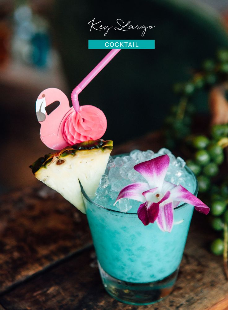 Key Largo Cocktail  1/4 oz blue curacao 1/2 oz lemon juice 1/2 oz orgeat 1 oz pineapple juice 1 1/2 oz white rum  Directions: Combine ingredients in a rocks glass. Add crushed ice, swizzle, and top with crushed ice. Garnish with an orchid and a wedge of pineapple.