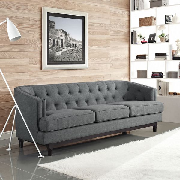 Provide your guests and family more seating with this Coast sofa. Upholstered in durable polyester, this button-tufted sofa has removable seat covers for easy cleaning. The extra wide seat cushions me