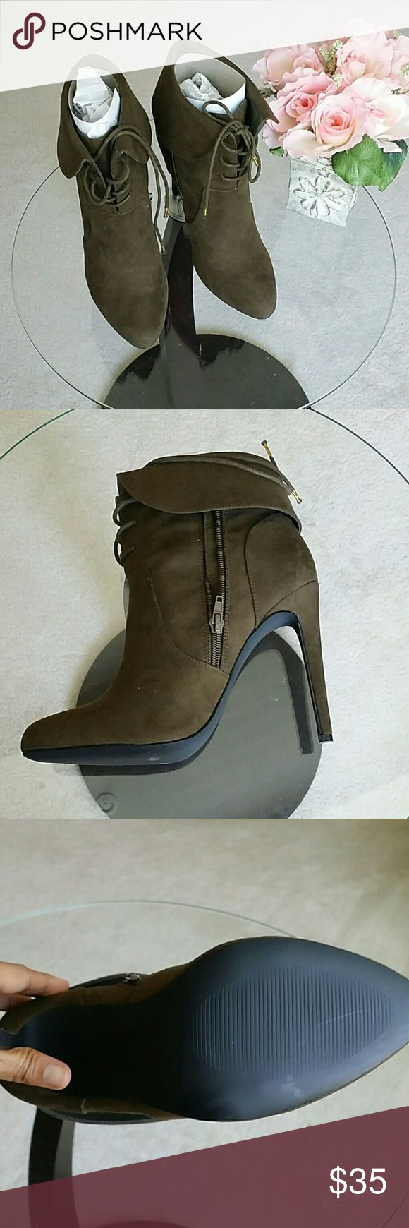 NWT Shoe dazzle booties size 9.5 M  Description : Cute booties l super sexy l  comfortable l heels 4 inches.  Material : Suede.  Color : Olive green. Condition : NWT Excellent no damage. Measurements : 9.5 M  Discount  with bundles. No trades  Shoe Dazzle Shoes Heels
