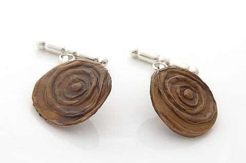 Bronze and silver cufflinks. The texture on thse was made using a hand carved rubber (eraser)