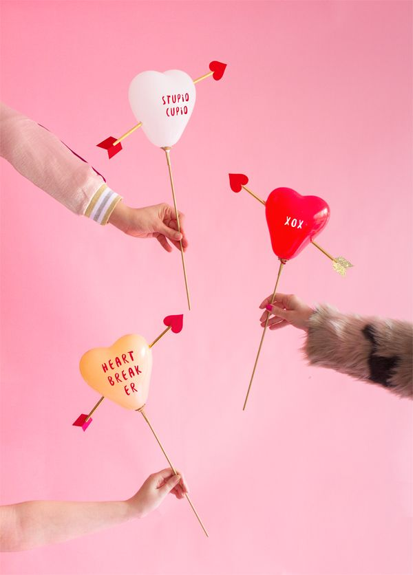 These adorable DIY 'cupid's heart' balloon sticks will be a fun decoration for the Valentine's Day party.