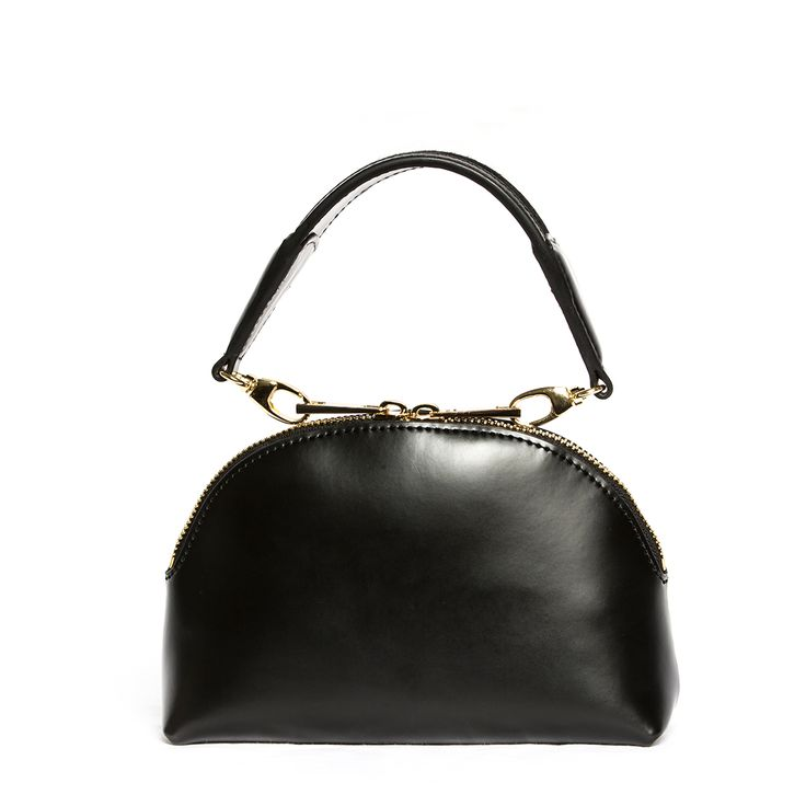 """X NIHILO's """"Stella"""" clutch is handcrafted from luxuriously smooth box leather to hold its curvy crescent silhouette. It's perfectly sized for your cell phone, keys and cardholder. Elevate your dressing game by carrying it by the pony haired wristlet handle, or remove and use it as a cosmetic pouch."""
