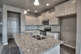 Image result for ashen white granite slab gray cabinet