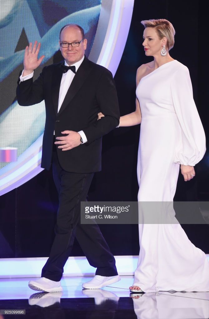Prince Albert II of Monaco walks on stage with his wife Charlene,Princess of Monaco during the 2018 Laureus World Sports Awards show at Salle des Etoiles, Sporting Monte-Carlo on February 27, 2018 in Monaco, Monaco.  (Photo by Stuart C. Wilson/Getty Images for Laureus)