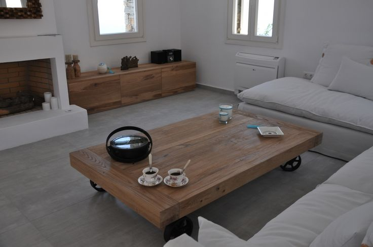 Custom made coffee table, solid wood, solid iron wheels, industrial style, Greek interior design