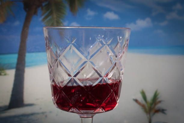 red wine glass with tropical tablecloth background