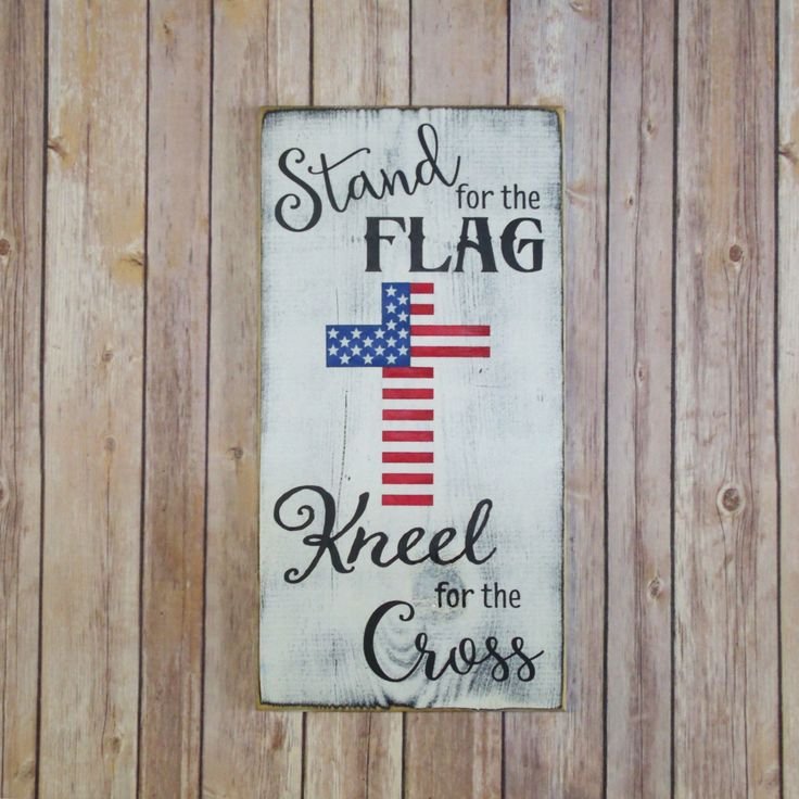 Stand For The Flag, Kneel For The Cross patriotic wood sign. Great Americana decor for year round decorating. Shows respect for the flag and the cross. Hand stenciled using Black, True Red, and True B