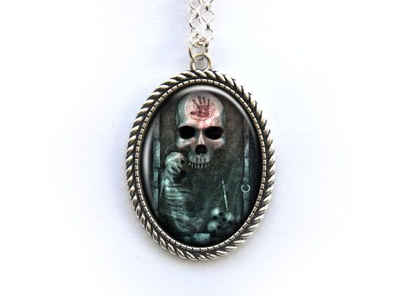 Beautiful necklace with a handmade altered art glass cabochon with an illustration of the Black Door.  Silver plated chain (nickel-free) and