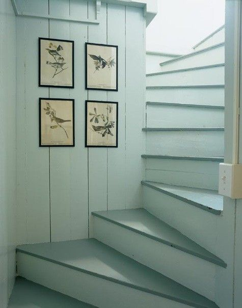 art collection inside painted attic stair