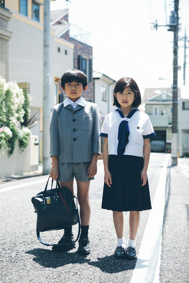.Japanese (?) school uniform   if anyone can identify this by the uniforms, the pin on her blouse, or maybe the emblem on the boys satchel... I will move to the correct board if not Japanese. Thanks, Charlotte.