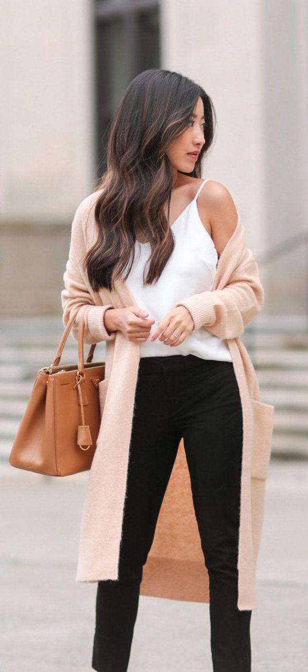 Camel duster, strappy white camisole + black slacks