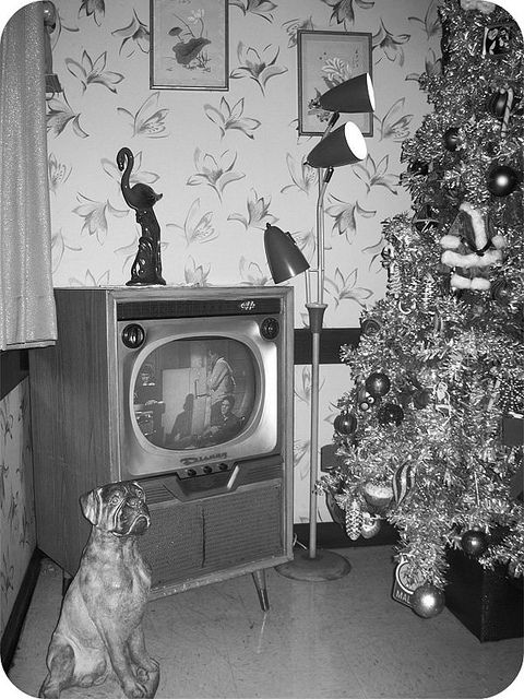 Christmas in the 50s - Oozes mid century modern: aluminum tree, pole lamp, and that tv -waiting to be switched over  to a Perry Como Christmas special!