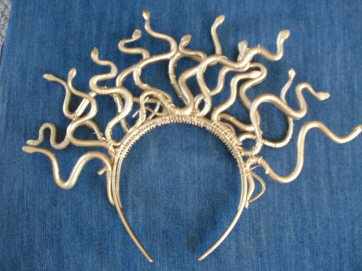 DIY Medusa Headband. Buy cheap plastic snakes at the dollar store (a few dozen in a pack), wire, a double banded headband, and a can of silver or gold spray paint. Wire the snakes onto the headband and then spray paint the whole thing.