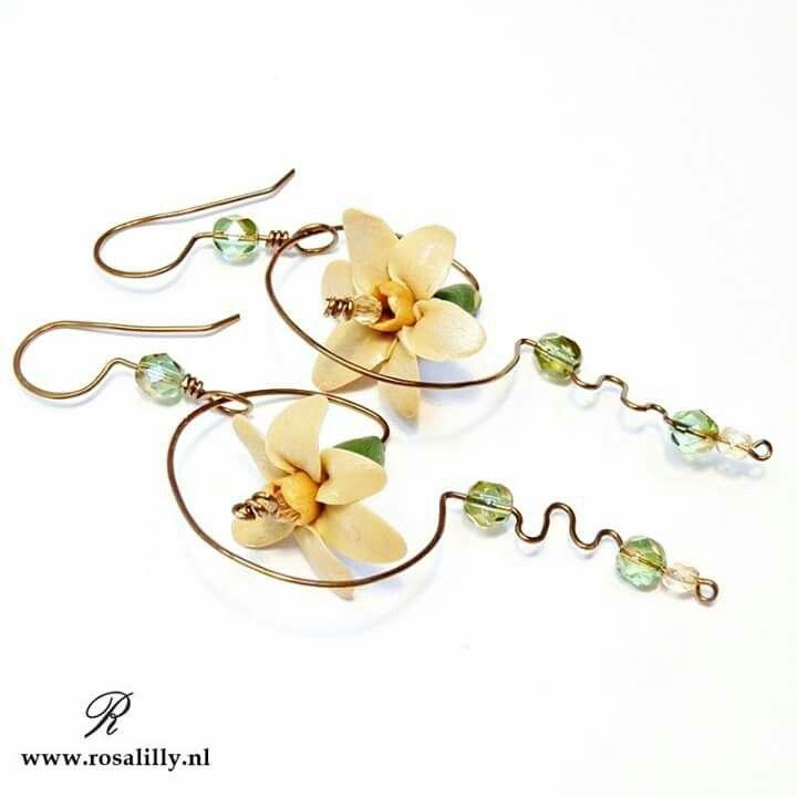 Handmade artisan earrings with daffodils.