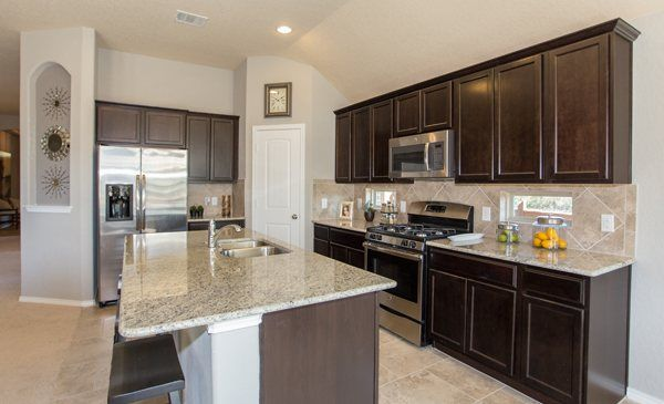 We Love The Tile Backsplash In This Kitchen From Lennar San Antonio Dark Wood Cabinets And