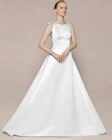 "Wedding Dress with Tuxedo Stripes PERSONALIZE IT    Satin tuxedo stripes and a dramatic A-line silhouette beautifully offset simple bows on the ""Kim"" gown, Birnbaum & Bullock, The Steven Birnbaum Collection."