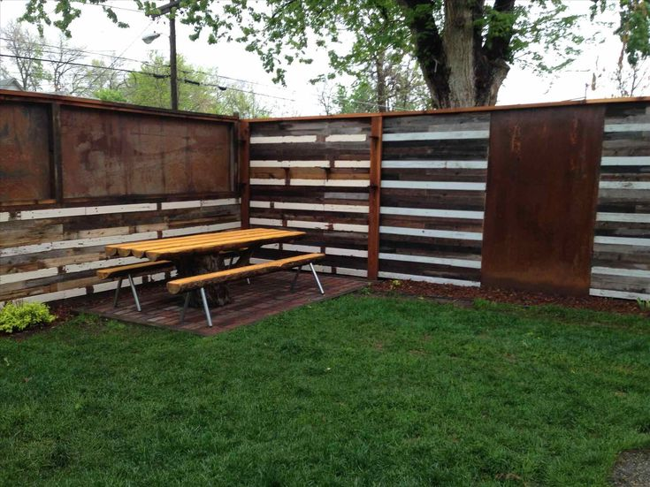 Metal Fence Made Using Old Corrugated Metal Roofing