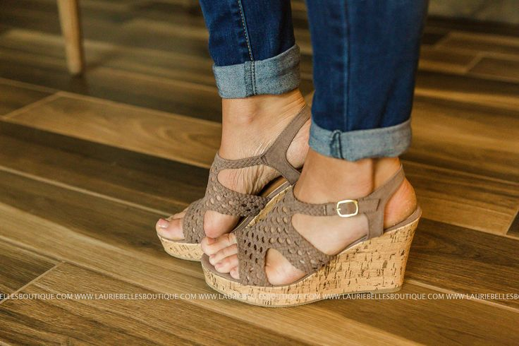 Cork wedge sandal with adjustable closure at ankle. Taupe. Approximately 3.5 inches tall.