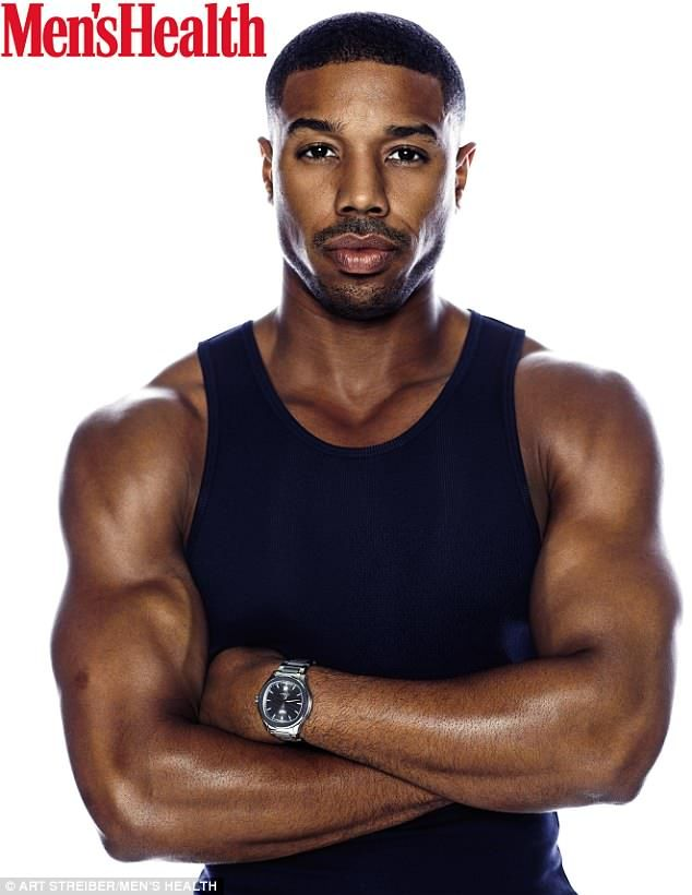 9246d7380bb18 On top of his game  Michael B Jordan looked very sculpted as he posed for  the cover of the May issue of Men s Health in a black tank top