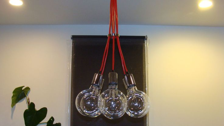 """DIY Edison light - $50.00 using 7 Ikea Hemma light bulbs, silver """"cups"""" which cover the sockets, and a metal canopy"""