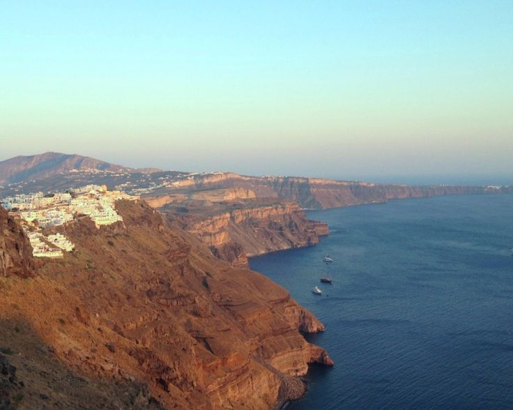 Santorini's dramatic cliffs glistening in the rays of another spectacular sunset...