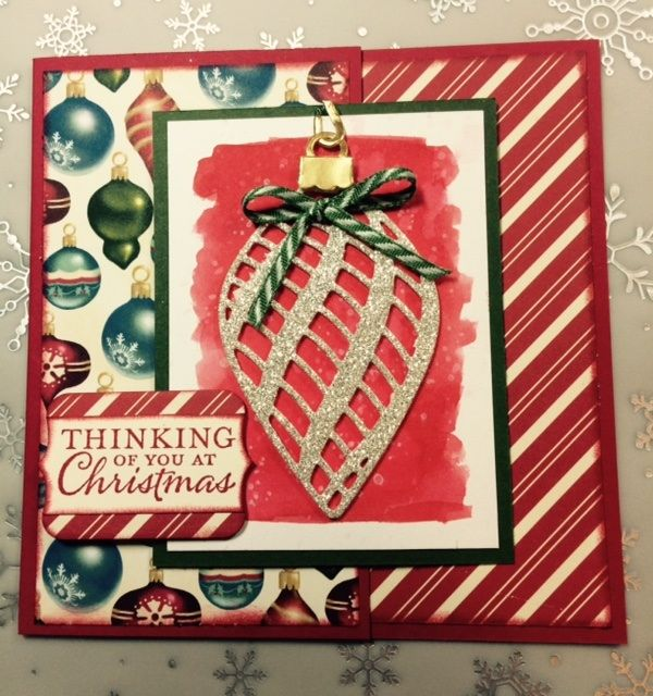 I watercolored the background for the Ornament Die and stamped over it with Gorgeous Grunge using Craft Whisper White Ink.