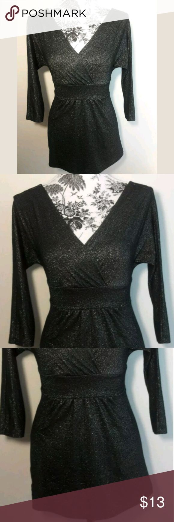 Express Shirt XS Black Silver Metallic Blouse Express  Womens Shirt Size XS Black W Silver Metallic Shimmer Empire Waist Blouse. Can be worn in and out of the office. Perfect for work or any special occasion. Simply Beautiful. A Must have!  Pre-owned in excellent condition.  Thank you for Looking & Sharing Happy Poshing😄 Express Tops Blouses